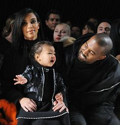 North West screams as her dad Kanye West tries to comfort her at the Alexander Wang show during NYFW on Feb. 14.