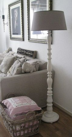 Like the use of a basket to corral blankets & pillows.