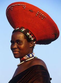 Africa | Zulu woman wearing her traditional hat - South Africa