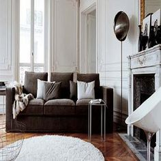 living rooms - brown couch, brown sofa, 3cushion sofa, trim moldings, marble fireplace, round rug, round sheepskin rug,  Loves it! chocolate