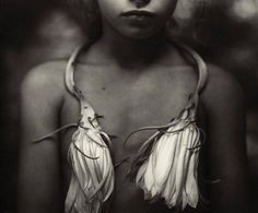 """Sally Mann finds beauty in her homeland her family in the animals she cares for on her 425-acre farm and in the simple human existence in living in this world. Her techniques include antique photographic processes and equipment. She loves the antique view cameras and bellows cameras from the late 1800s and early 1900s and she enjoys using large format glass negatives platinum and bromoil printing and in the mid-1990s she began using the collodion wet plates in her work lending to a feel of…"