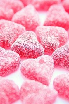 Pink hearts candy sprinkled with sugar.