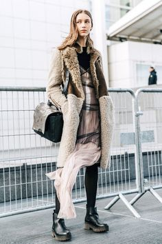 Although we're just starting the fall season, this striking street style shot has us wanting to stock up on a stylish shearling coat in anticipation of the colder weather to come. The cozy must-have thankfully comes in a variety of colors and shapes that fit every personal style. As for styling them, it's a cinch. We basically consider the textured outerwear a neutral at this point since it's perfect for completing any look.