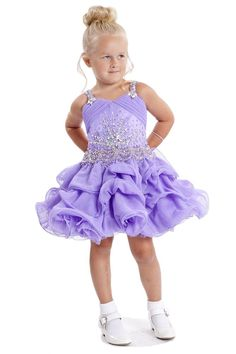 The+dress+is+made+of+high+quality+tulle+Fabric  Simple+cut+with+ruffles+along+the+dress  Decorative+beading+on+the…