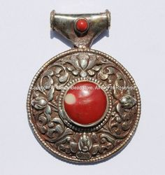 Large Tribal Ethnic Tibetan Round Pendant with Repousse Carved Lotus Floral Details & Red Colored Resin Coral Inlays Quantity: 1 pendant The Lotus Flower is one of the 8 Tibetan Auspicious Symbols. It