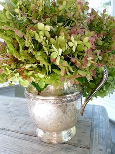 flowers in a silver pitcher - love this!