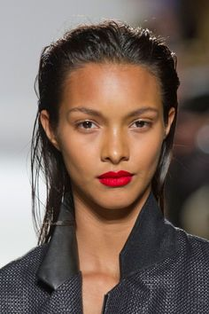 fresh makeup for summer,   minimal eye makeup, bronzed dewy skin and red lips worn with an all white outfit, perfetto!