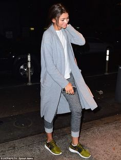 Dressed down: Zendaya wore rolled up sweatpants and trainers, along with a T-shirt under a long coat