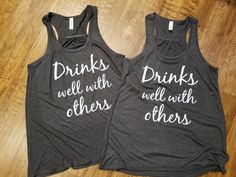 Drinks Well With Others Tank Top//Flowy Drinking Tank//Womens Drinking Racerback Tank Top//Workout Tank Top//Summer Tank Top//Vacation Tank  Welcome to Sheribottomline! This listing is for one Flowy Racerback Tank Top that says Drinks well with others. Great tank tops for family vacation or for summer get togethers! These tank tops are SO cute, light and flowy! This is my new favorite style of tank. It is positively wonderful for those hot summer days! **Please note that the main picture is…