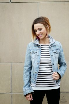 Stripes, gray hoodie layered with a denim jacket, black jeans and white ankle boots - I would wear my taupe ankle boots.