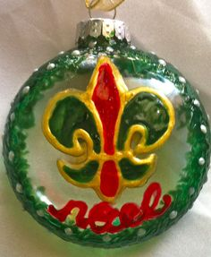Couture New Orleans crafts that bring handmade Crescent City elegance to your home and events year round. Pearl Studs, Door Wreaths, New Orleans, Christmas Bulbs, Hand Painted, Etsy Shop, Shapes, Grandparents, Holiday Decor