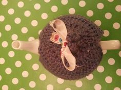 Blue crochet tea cosy and buttons ribbon