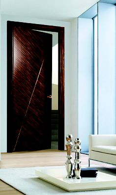 The Makassar Collection has a distinct aesthetic, combining the warm tones of real ebony veneer with hand crafted golden detailing, intersecting striking geometric shapes. Makassar doors have a unique layered surface which creates added interest as light plays on its multiple surfaces.