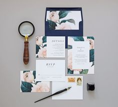 Vintage floral etchings paired with navy accents and contrasting typography adorn this botany-inspired wedding invitation suite. The perfect
