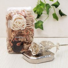 All that glitters is not gold. However, here get the opportunity, to have in your possession silvery along with a transparent packet of floral delights. Diwali Gift Items, Diwali Gifts, All That Glitters, Potpourri, Floral Arrangements, Gift Wrapping, Gift Wrapping Paper, Bowl Fillers, Flower Arrangement