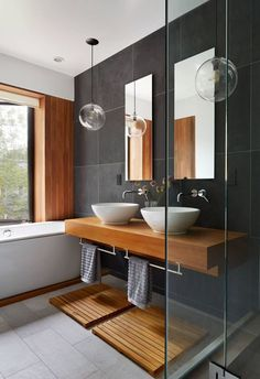 Wooden bathroom with grey tiles. Modern, elegant with a touch of traditional.