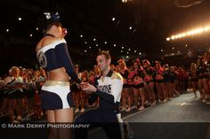 Britney (the girl) hurt her ankle while competing and was sitting at awards in the middle of the floor with the whole strip in front of her cleared. Her boyfriend (now fiance) Tanner tumbled down the empty strip through to an arabian and landed on one knee and proposed. Anwww