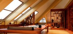 An attic doesn't have to be dark and cramped. Why not open it up with windows and some clever interior design?