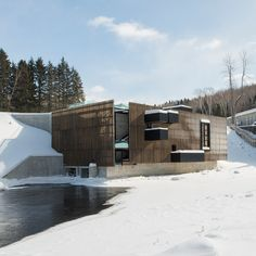 """Slatted timber envelopes this hydroelectric plant by Atelier Pierre Thibault on the Ouiatchouan river, which runs through a """"ghost town"""" in Qsituebec"""