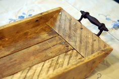 These rustic trays are hand-crafted from reclaimed farm wood, and each one is unique in wood color and character.  http://www.numenaturalsoap.com/product/farmwoods-tray-standard-size-with-iron-handles/#