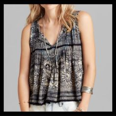 Free People split back printed tank Pretty printed tank with 3 ties in the back. Pretty aqua blue stitching through the pinprick front. Intentional raw edges. 100% rayon. Retail $68.                                      #128 Free People Tops Tank Tops