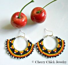 Halloween, Autumn, Fall multi colored seed bead hoop earrings made with glass seed beads in shades of orange, yellow, white and black on silver