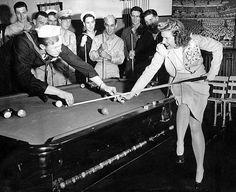 Couple playing billiards, 1943.