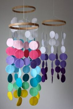 Mobiles made from wooden rings and felt circles.