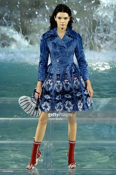 Kendall Jenner with curly hair!  This hairstlye.  She walks the runway at Fendi Roma 90 Years Anniversary fashion show at Fontana di Trevi on July 7, 2016 in Rome, Italy.  (Photo by Victor Boyko/Getty Images )