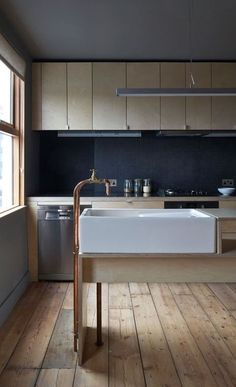 interior. exterior. kitchen. bathroom. sink. plumbing parts faucet. spigot. cabinet. light wood. dark grey backsplash. http://www.remodelista.com/posts/trend-alert-10-diy-copper-piping-faucets-homemade-kitchen-and-bath-faucets/