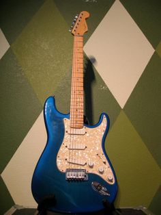 The very first guitar I bought with my own money. A 1994 Fender American Strat Plus Deluxe (fancy, fancy).  Old faithful I guess.