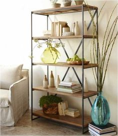 Maybe use the metal shelving in the sunroom instead of the basement- use a dark, powdered finish and have nice wood shelves cut to fit.