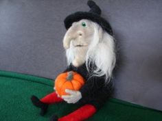 Halloween Witch table decoration, hand made needle felted from wool and holding her pumpkin. by FeltTheFluff for $110.00