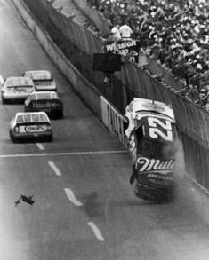 Bobby Allison shreds a right rear tire at Talladega. After this crash, Nascar made the restrictor plates for the Superspeedways to slow the cars down.