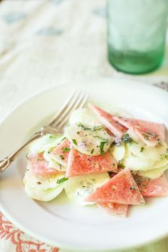 Cucumber and watermelon salad *1/2 small seedless watermelon (about the size of a cantaloupe) 1 cucumber 2 Tbs plain yogurt (sub coconut) 1 tsp ea. chopped Mint, Thai basil, and Dill