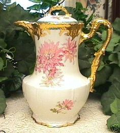 GORGEOUS VINTAGE LIMOGES CHOCOLATE POT MUMS 1900...You are bidding on a gorgeous Limoges Chocolate Pot with Mums decoration encircling it. It is in excellent condition, with no chips, cracks or repair