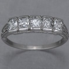 Art Deco Style Wedding Band - I would swap Ascher cut for round diamonds, though