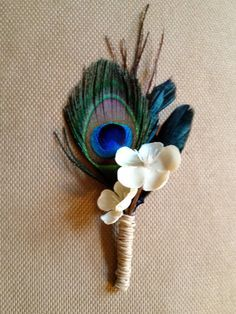The mister loves this one!  Woo hoo!  Peacock Boutonniere... Love this!  Trimmed peacock feather, we'd have to replace the flower with something we're using.