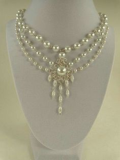 This beautiful and elegant necklace displays an array of shapes and sizes of white pearls with a central, chandelier style setting, for Bridal Necklace, Wedding Jewelry, Beaded Jewelry, Handmade Jewelry, Personalised Jewellery, Beaded Necklace, Gold Necklace, Motifs Perler, Victorian Jewelry