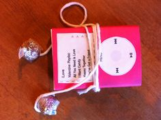 A great idea for Valentines gift. Sweetheart candy box with home made iPod cover and Hershey Kisses on string to create the earphones.