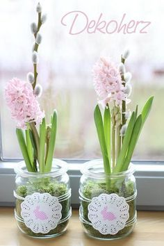 Recycled jars with moss, hyacinth, pussywillow & doilies