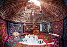 Photo about Ethnic nomadic house yurt interior with table of national food at Nauryz celebration. Image of cuisine, feast, kazakh - 51873378 What Is A Yurt, Mongolian Ger, Building A Yurt, Yurt Interior, Interior Photo, Interior Design, Yurt Tent, Yurt Home, Yurt Living
