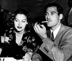 Errol Flynn and Ava Gardner out on the town, circa early 1940's