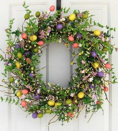 This wreath is decorated with Spring floral and Easter egg garland, the colors of the eggs are yellow, purple, green and salmon pink. The garland