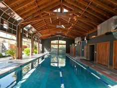 Garage doors! Indoor outdoor pool!! The barnhouse pool at the Lake Austin Spa.