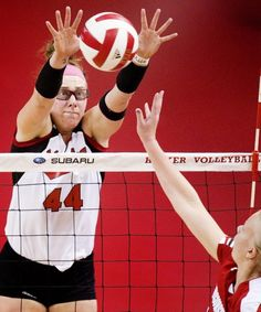 Nebraska's Hannah Werth (left) goes up for a block against the shot of Wisconsin's Julie Mikaelsen in the third set on Friday, Oct. 12, 2012, at the NU Coliseum.