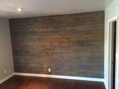 "Create a feature wall! Buy assorted sizes of 1"" pine plank, use a nail gun to attach, alternate each rows plank size, once all boards are up stain with one light coat of Minwax ""classic grey"" add trim and viola!"