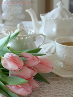Tea and tulips!  Love the white.  It just lifts the spirits and all colors around it.