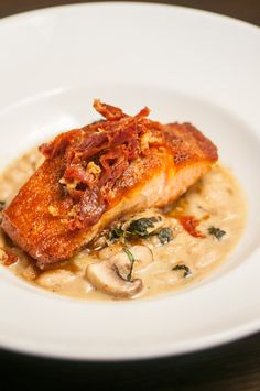 PAN-ROASTED SALMON white beans, fennel, mushrooms, prosciutto cracklings, bacon vinaigrette Stone Crab, Pickling Jalapenos, Cocktail Sauce, Roasted Salmon, Roasting Pan, White Beans, Dinner Menu, Prosciutto, Fennel
