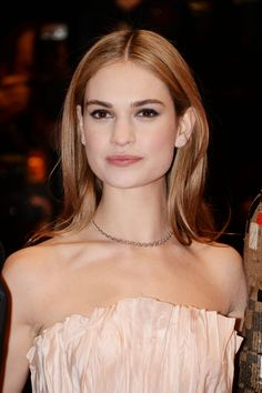 A round-up of Lily James' best beauty looks throughout her Cinderella tour. Who Plays Cinderella, Cinderella Hair, Wedding Hairstyles, Cool Hairstyles, Hairstyle Ideas, Actress Lily James, Wedding Hair Inspiration, Bridal Updo, Gorgeous Makeup